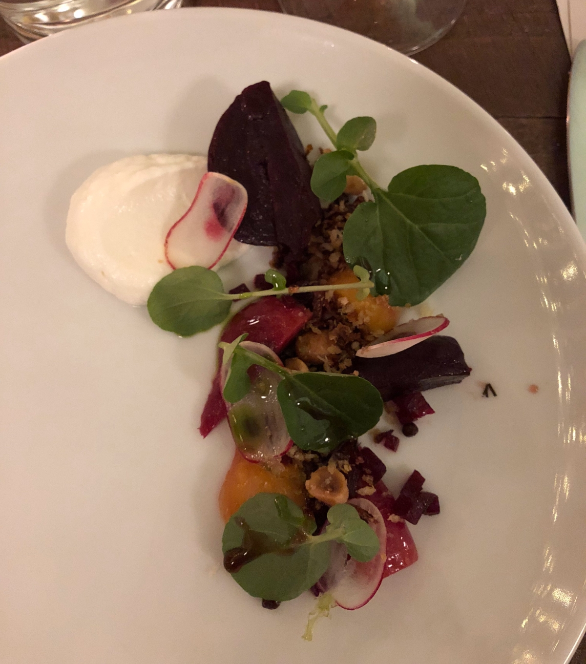 Roast young beetroots, goat's curd, hazelnuts, radish and dill